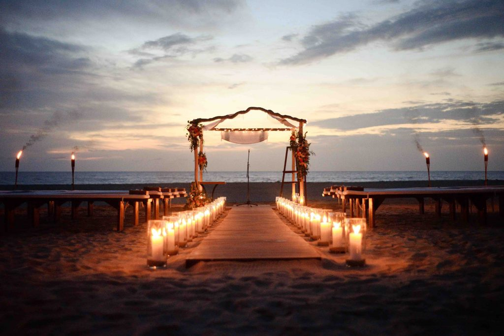 Beach ceremony with candle decor