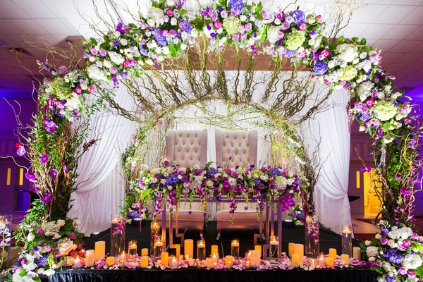 sweetheart table with flowers, greenery and, candles