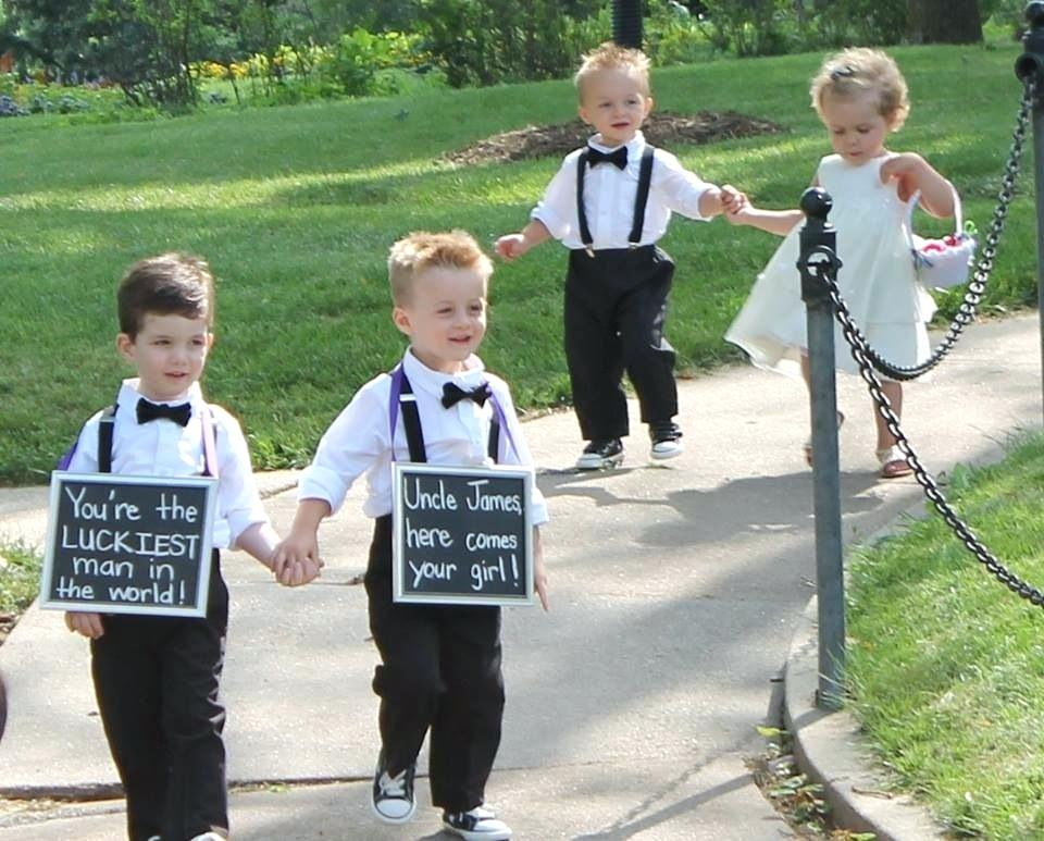 luckiest man in the world sign held by ring bearers strolling down to the ceremony