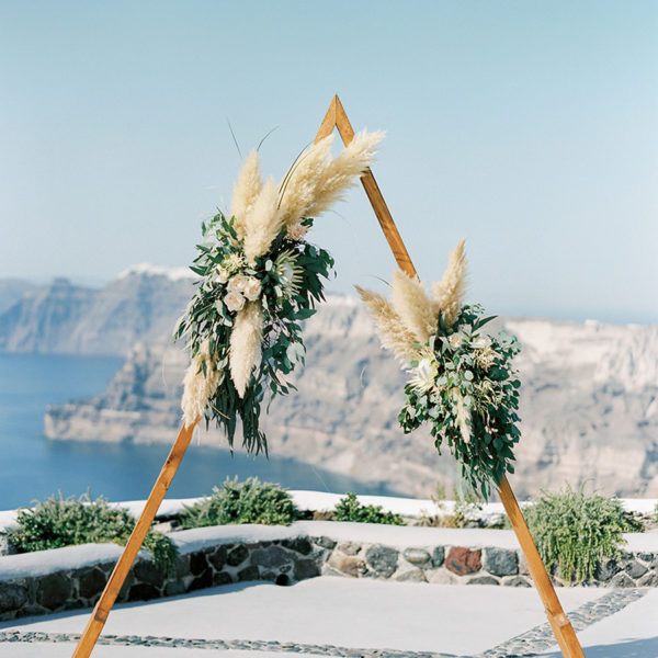 Wooden wedding ceremony backdrop with flowers