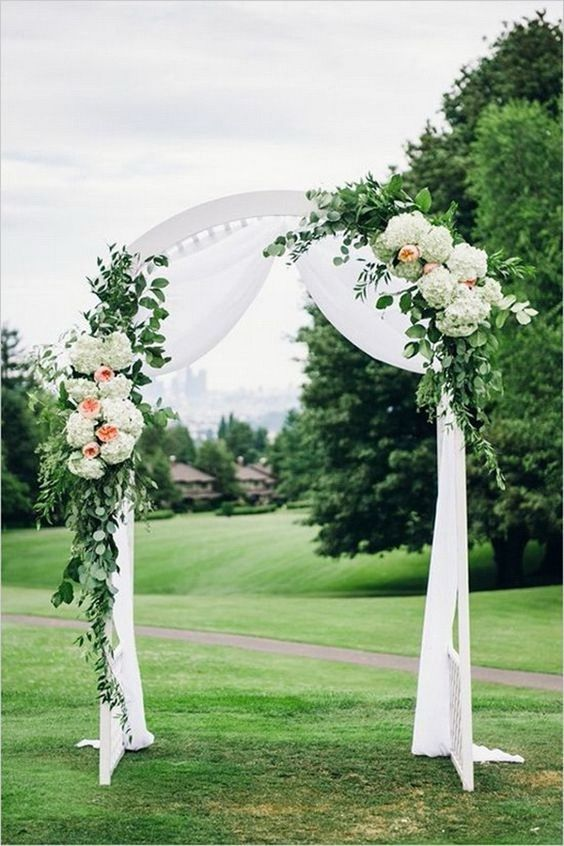 wedding ceremony backdrop in field