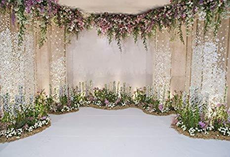 Flowers and drape wedding ceremony backdrop