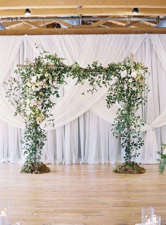 Green arch and drape wedding backdrop