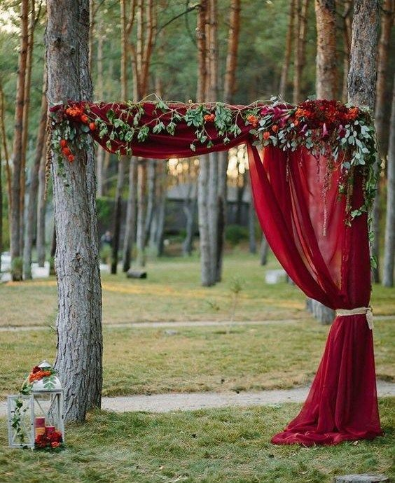 nature red drape ceremony backdrop