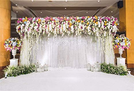 colorful flowers and drape backdrop wedding ceremony