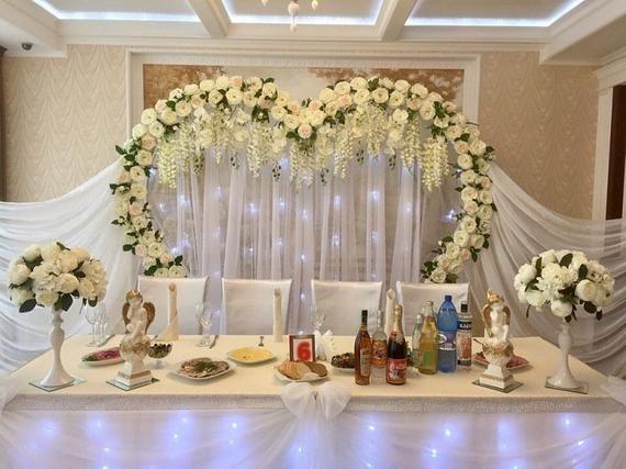 white flower heart shape backdrop for sweetheart table