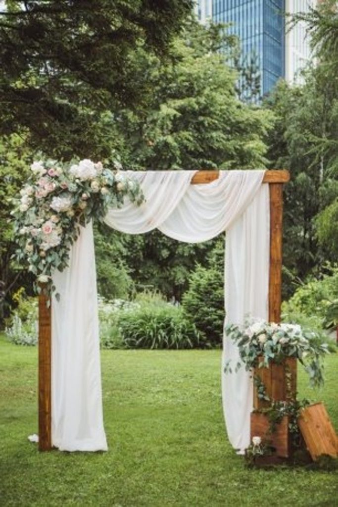 Drape and flowers wedding ceremony backdrop