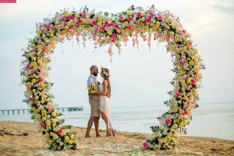 Beach ceremony floral heart shape decor