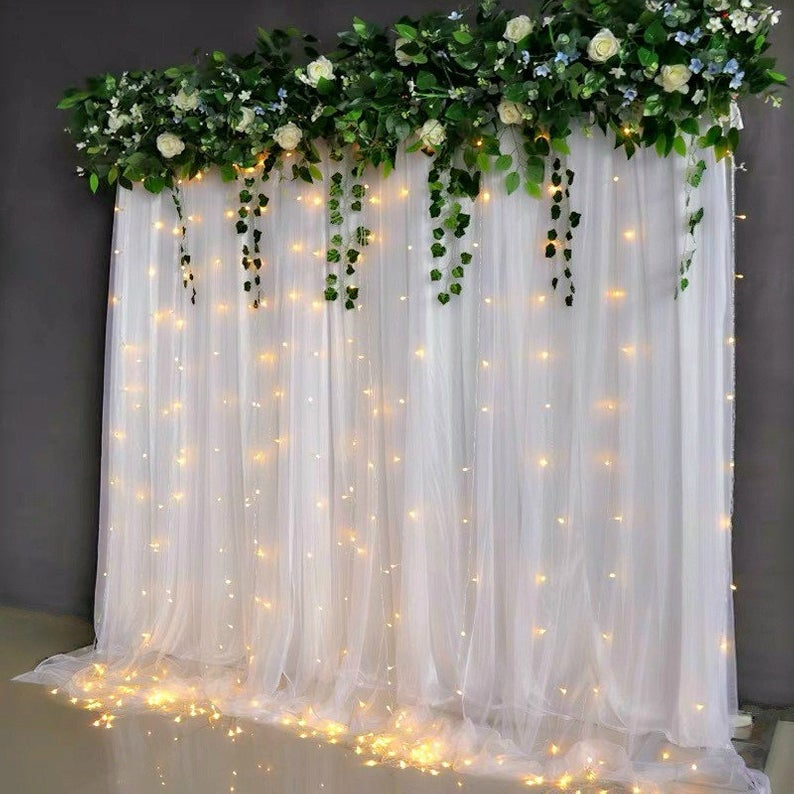 Green top drape and lights wedding backdrop