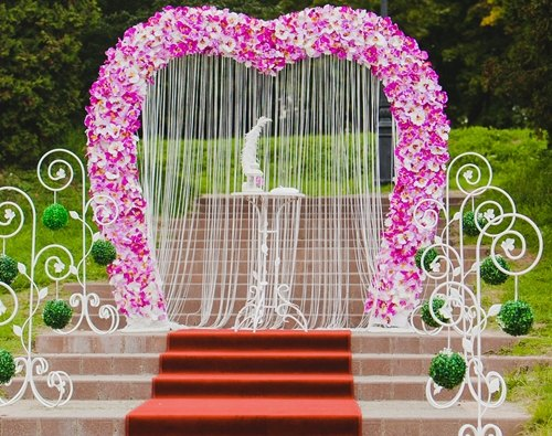 pink white flowers heart arch