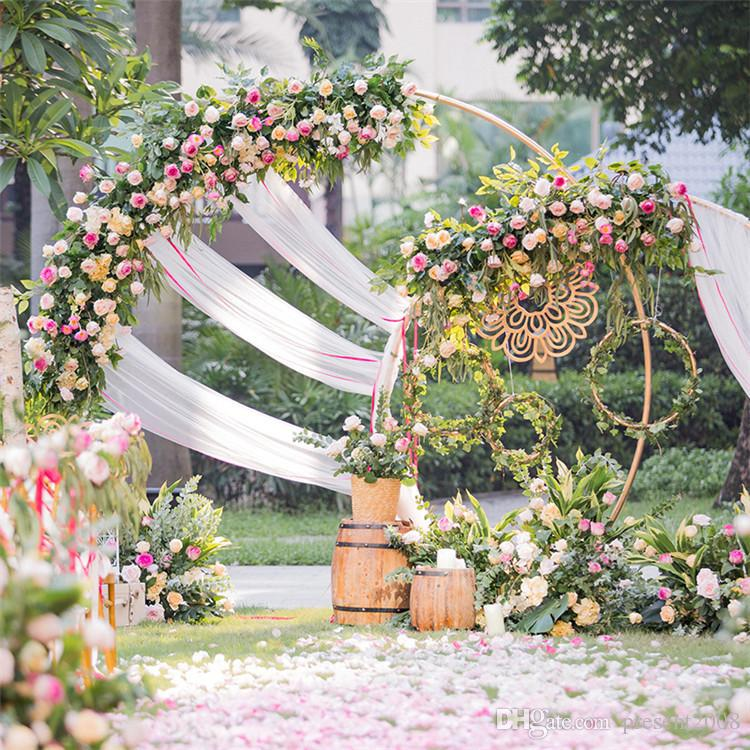 Sweetheart table round arch with flowers