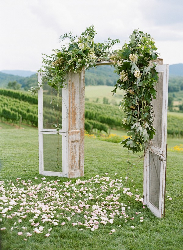 rustic floral decorated wedding arch ideas with door