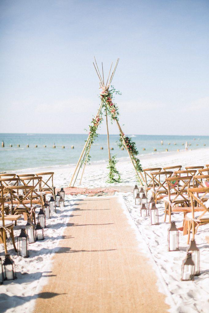 Beach wedding ceremony teepee