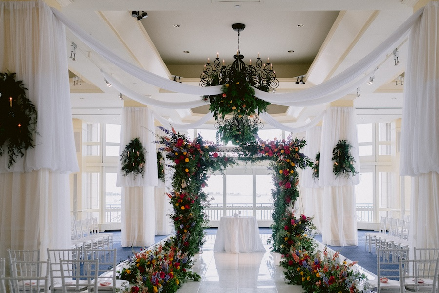 beautiful floral runway into backdrop wedding ceremony