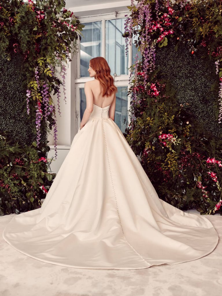 Rita-vinieris-Rivine-Voluminous-satin-kiss-pleated-ballgown-with-delicately-arched-neckline