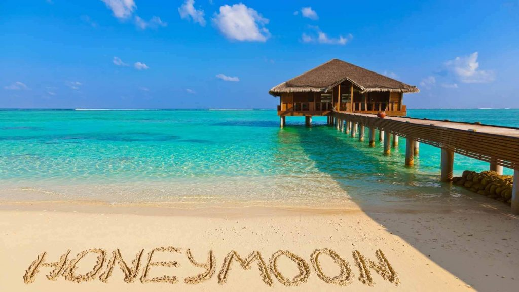 honeymoon-beach-sand-overwater-bungalow