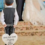 Happily ever after sign held by ring boy
